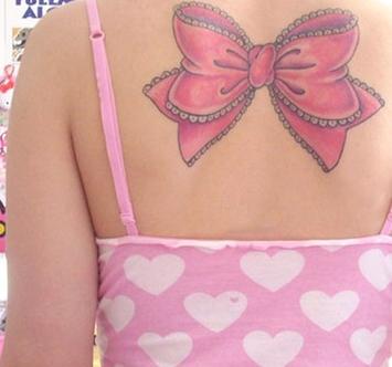 Stripper tattoo lower back