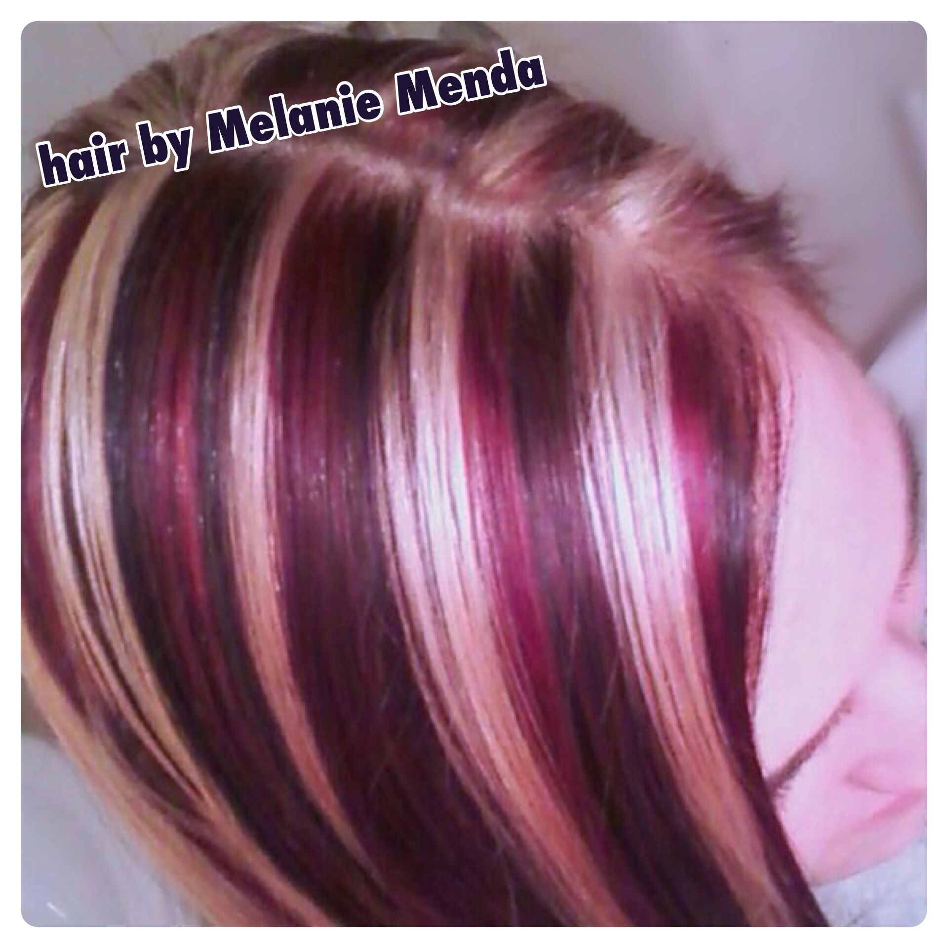 Heavy slices of brown red and blonde on level hair highlights