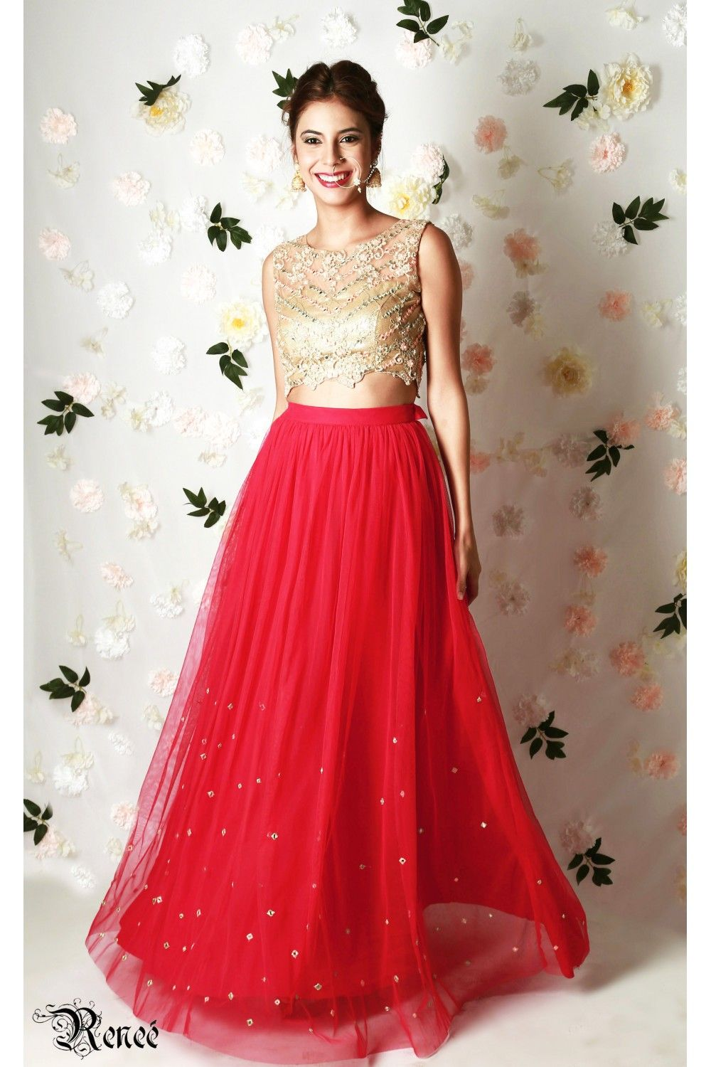 d3e2b4a0b84 Rose-red lehenga in net tulle with mirror embroidery and a gold crop top in  net with thread