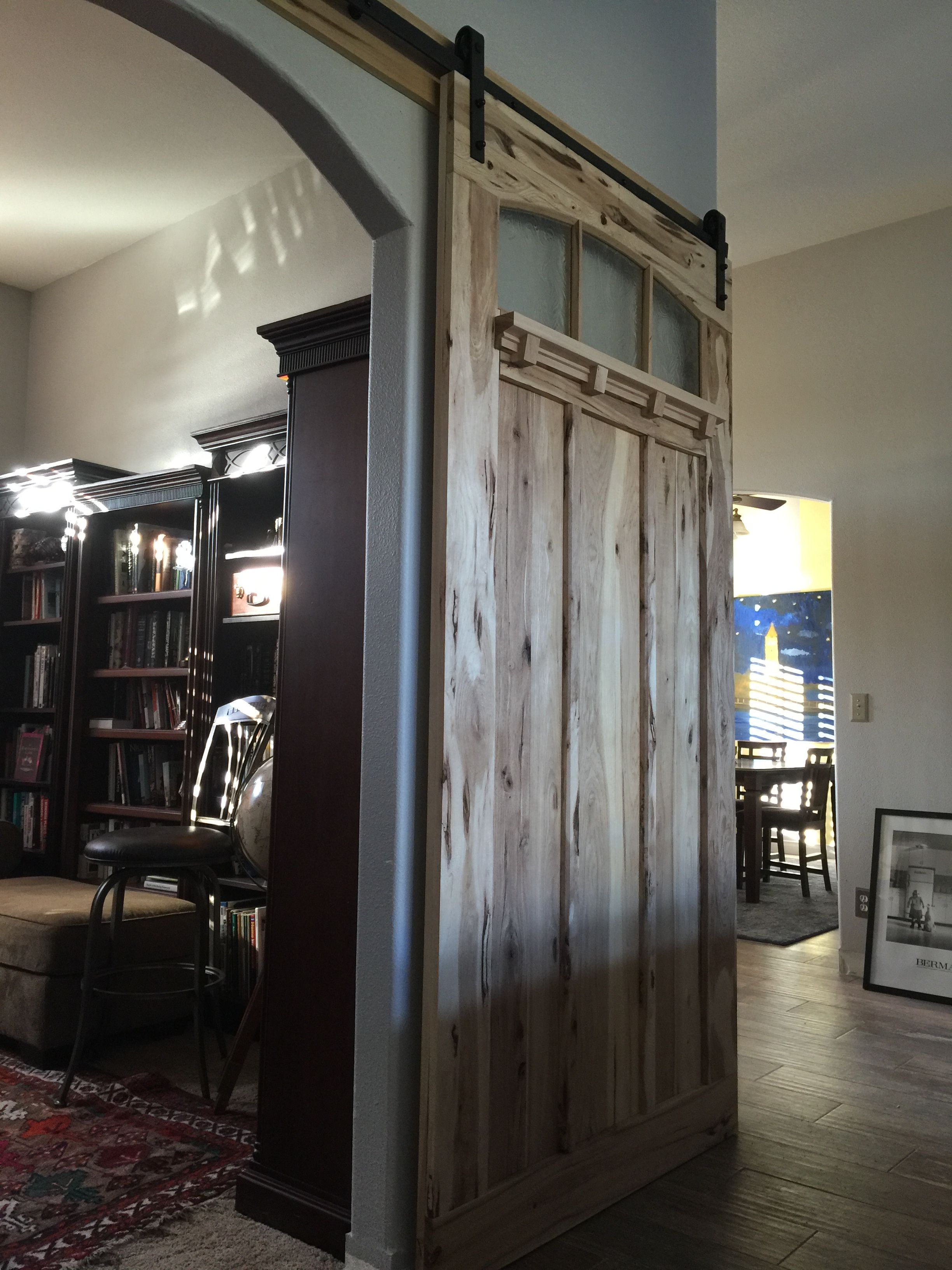 Interior Sliding Barn Door Made Of Hickory And Textured Glass