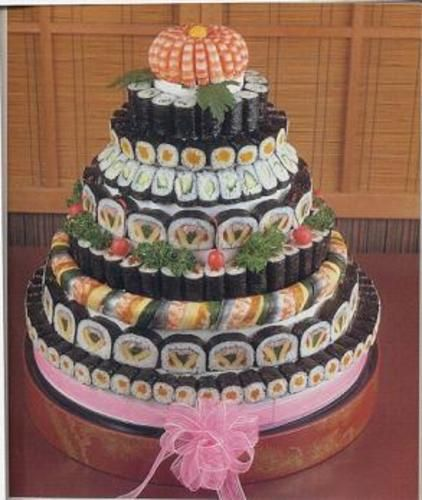 sushi wedding cake. I would do this if it wouldn't cost more than