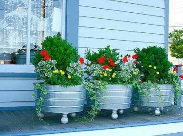 galvanized tubs from tractor supply with red plants from Home Depot ...