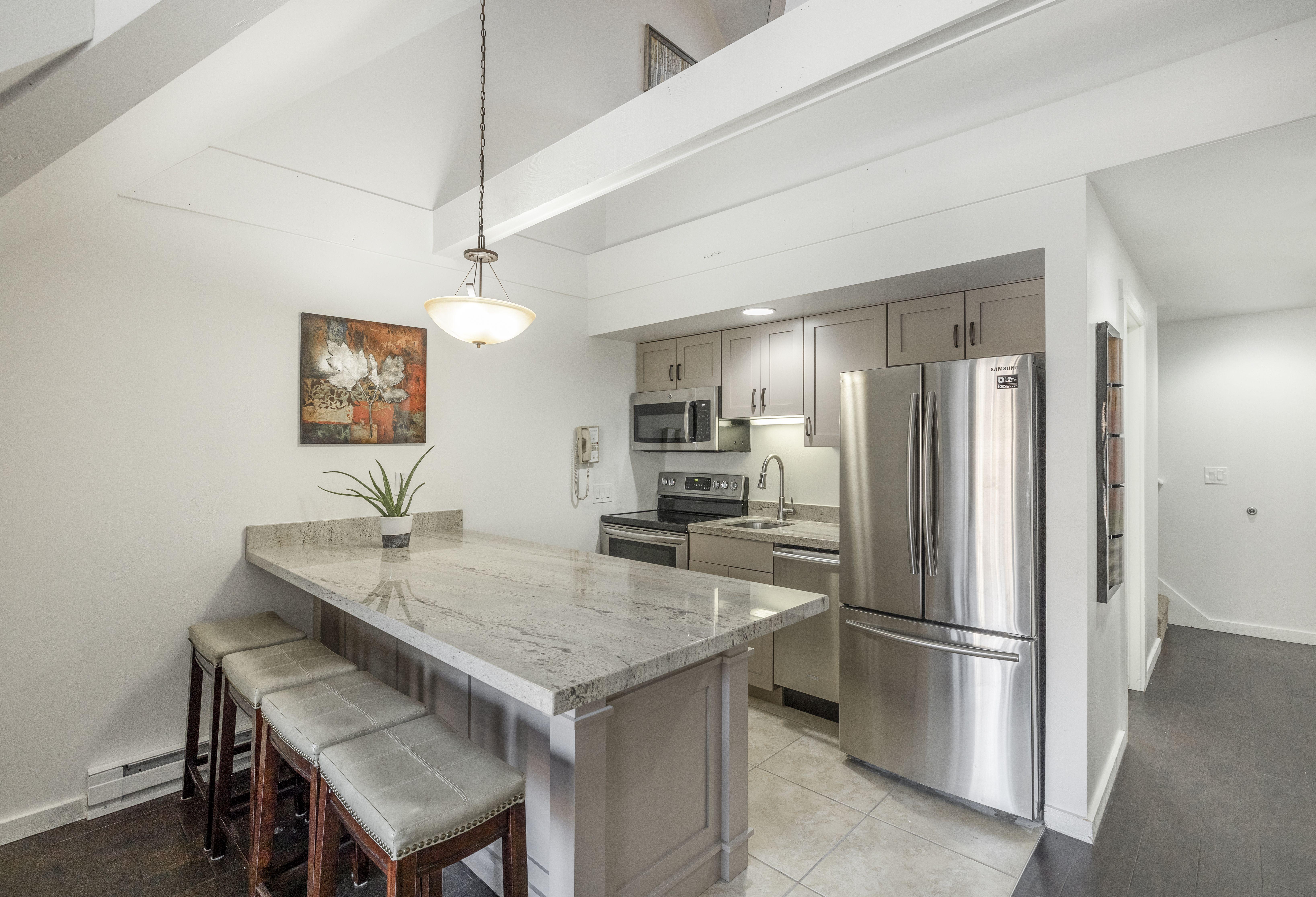 1385 Lowell Ave 303 Park City, UT 84060 #WindermereUtah #RealEstate #ParkCity #Utah #CondoLife #Kitchen #KitchenIsland #BarStools #KitchenArea #KitchenDesign #HomeDesign #HomeDecor #Condo #UtahLiving #ParkCityLife #ParkCityCondo #SkiInSkiOut