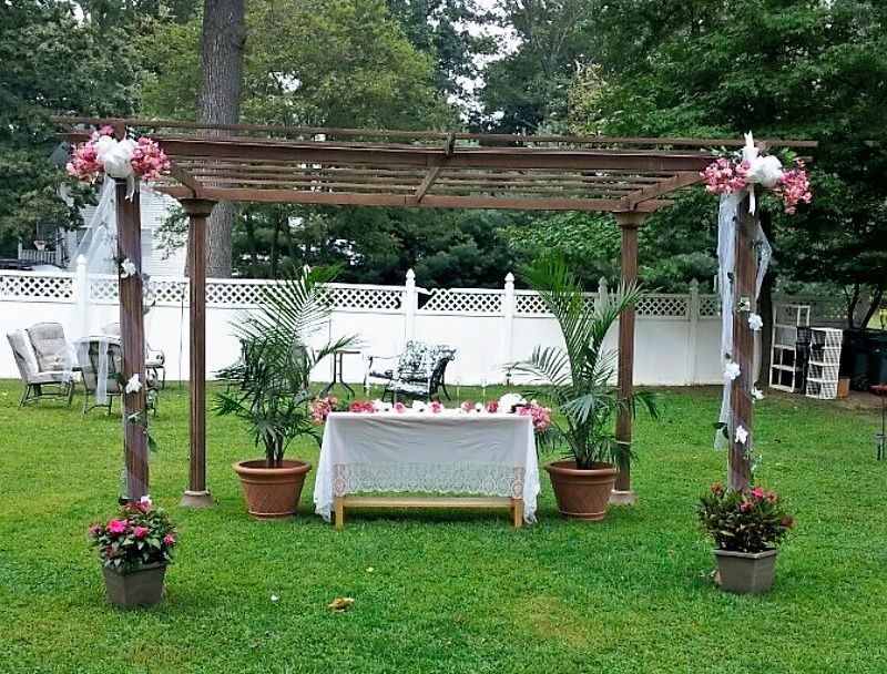 Sometimes less is more...turned a coverless structure inot wedding alter