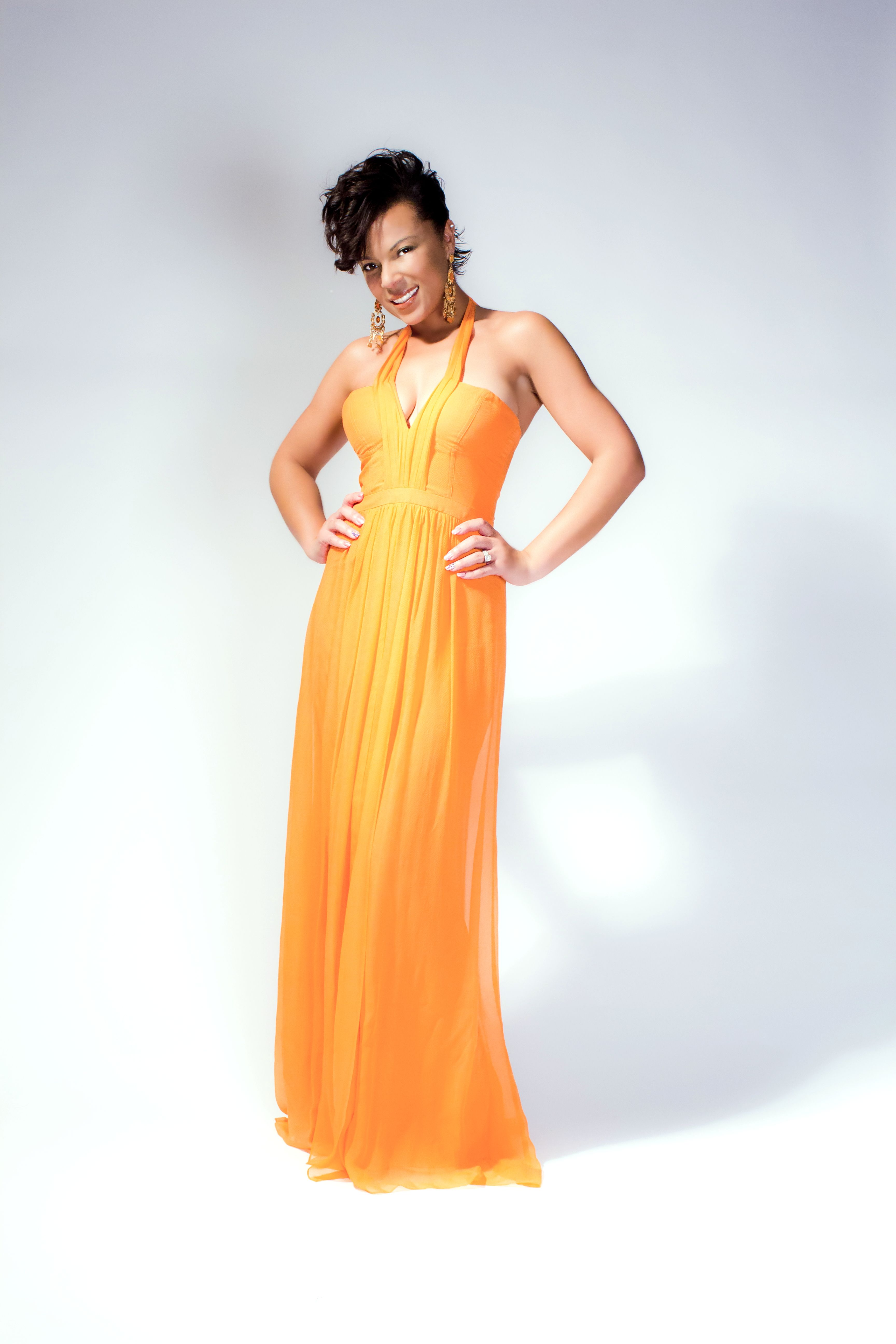 Step into spring with sadiesha wearing a beautiful orange gown by