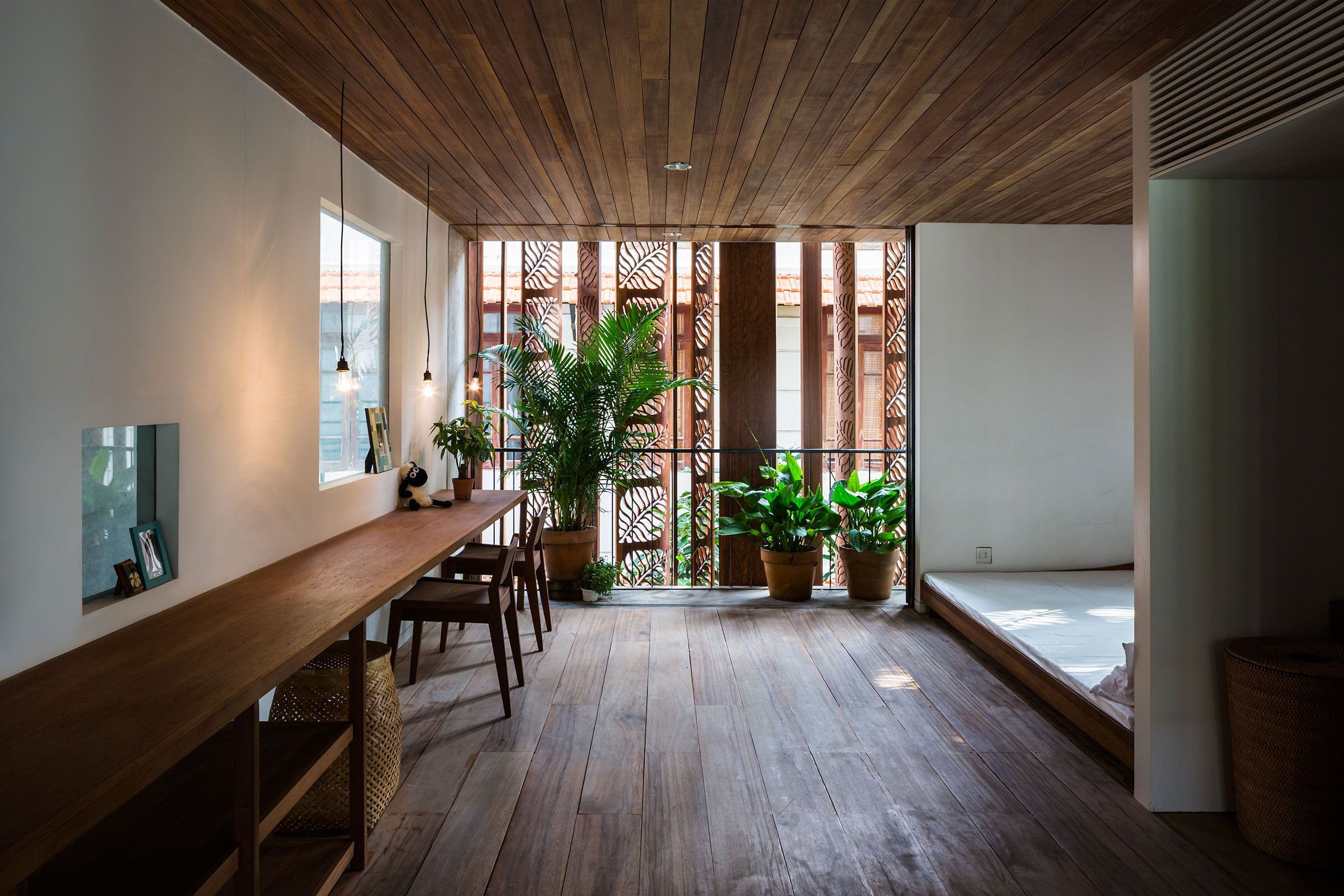 Situated in a new residential area of Ho Chi Minh City in Vietnam, this multi-storied family residence is a reinterpretation of the local architectural vernacular, both in terms of composition and use of materials.