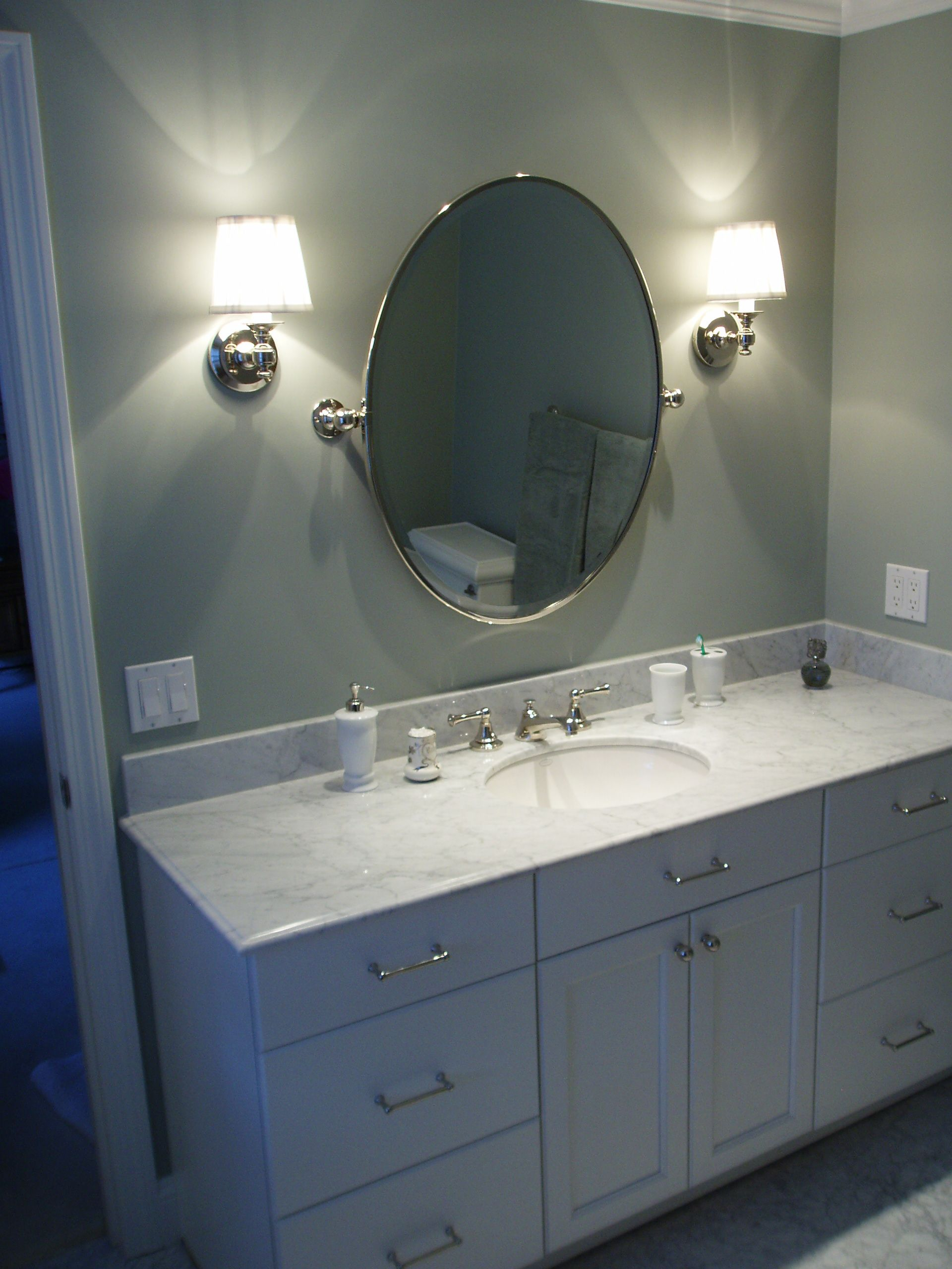 Classic bathroom vanity design white vanity carrera - Round mirror over bathroom vanity ...