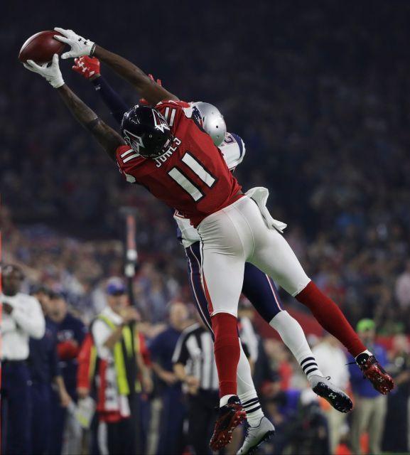 Atlanta Falcons Julio Jones 11 Catches A Pass As New England Patriots Defender Eric Rowe Attempts To St Falcons Football Atlanta Falcons Atlanta Falcons Art