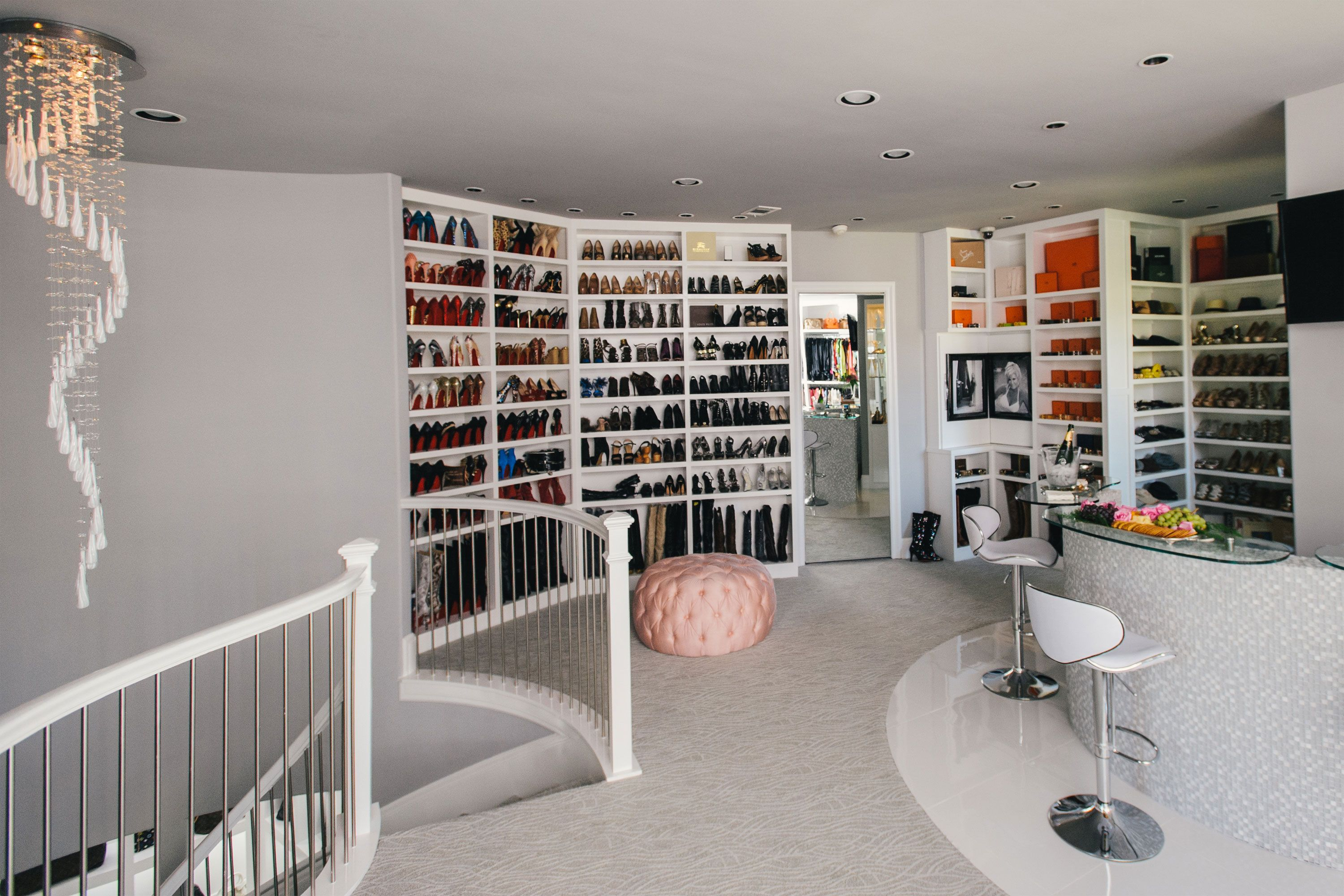 The Biggest Closet In America A Spiral Chandelier Sits Atop Staircase