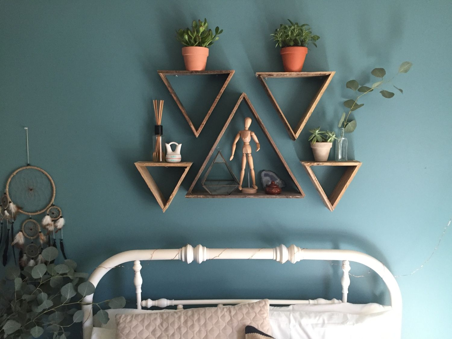 The shelves are totally unique and one of a kind as they are made from old wooden pallets! The photos are from my room and I LOVE the shelves above my bed! The possibilities are endless as these shelves work well alone or in a grouping. With multiple triangle shelves of various sizes you can create amazing, functional wall art.