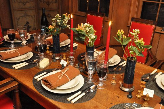 The table  set with Simon Pearce dinnerware and glassware  Chilewich  placemats  Sabre cutlery. The table  set with Simon Pearce dinnerware and glassware