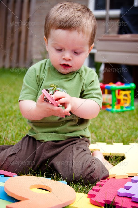 Child playing with his toys ... alone backyard boy caucasian child chubby  cute fun happy infant kid merry one outdoors outside playing toys