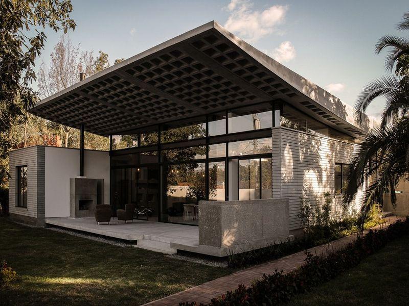 Maison contemporaine en béton à toiture courbée en Equateur