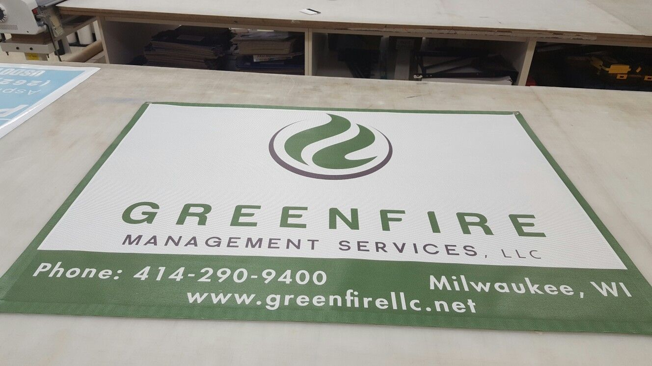 FASTSIGNS of Menomonee Falls mesh banner, made for Greenfire Management Services. Check us out at fastsigns.com/452, call us at #262-253-0799, email us at 452@fastsigns.com, or come visit us at W173N9170 St. Francis Drive, suite 1, Menomonee Falls, WI 53051