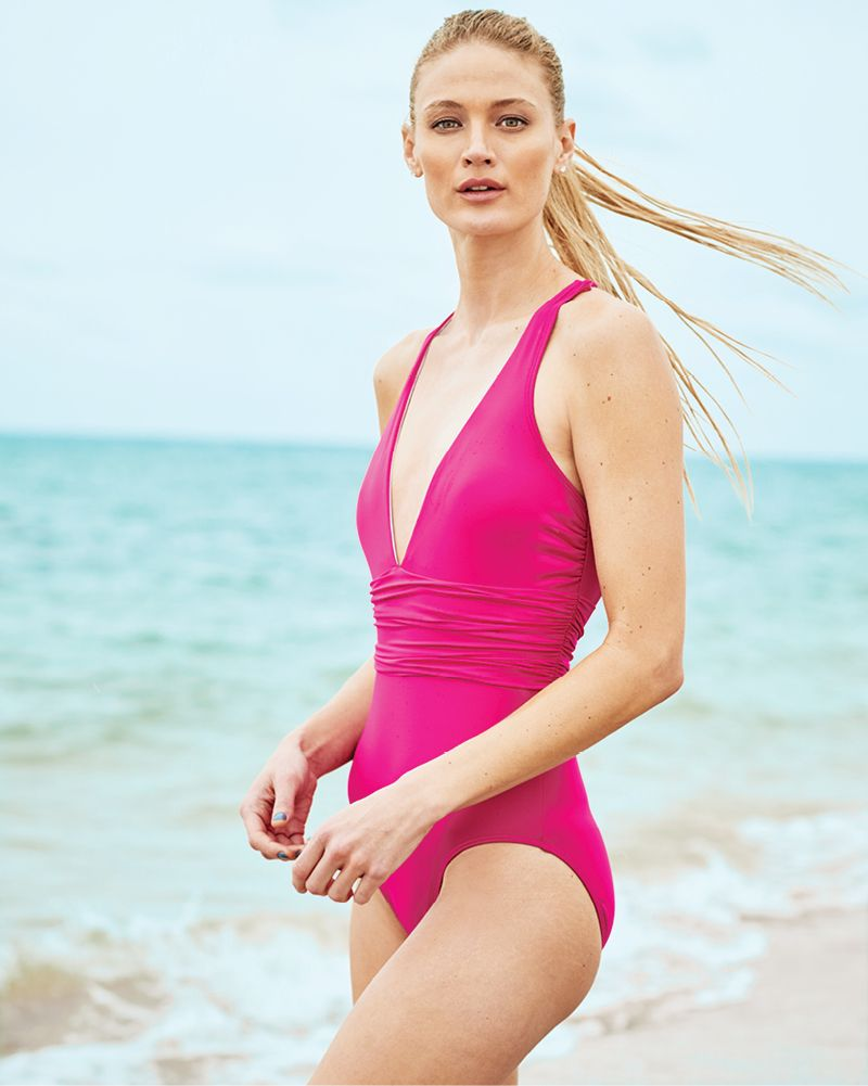 70a81322af409f Simple, sleek and sophisticated — this deep v-neck one-piece swimsuit from  Lauren Ralph Lauren is crazy flattering thanks to ruched details.