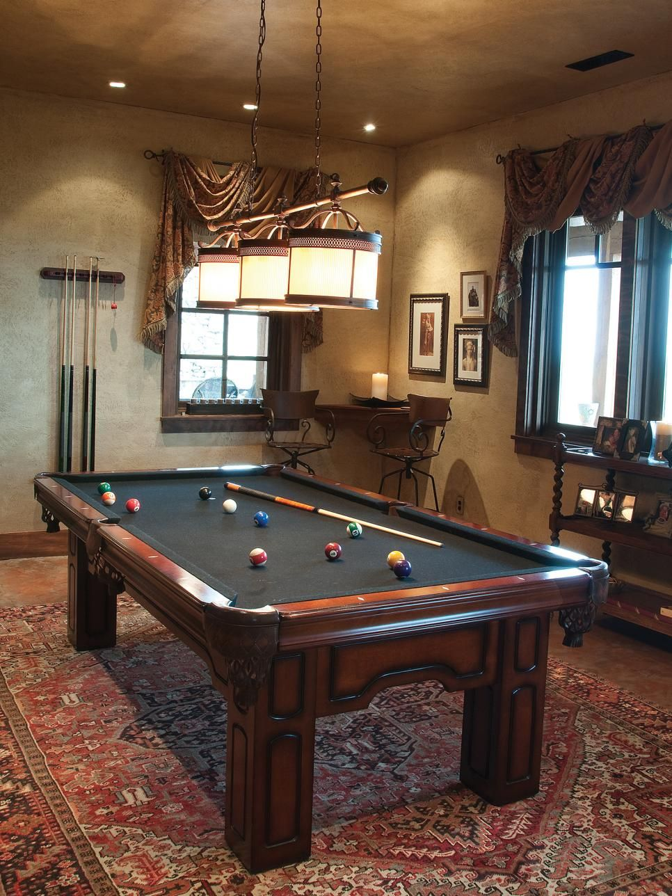 A lotuspattern Oriental carpet and antique pool table