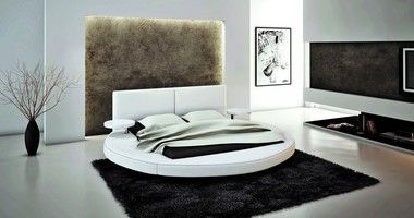 "Set Includes: One Queen Size Bed Frame White Bonded Leather Round Bed Build in Lightstand Product Dimensions: Queen: W104"""" x D99"""" x H39""""  Product Materials: Texture Bonded Leather"