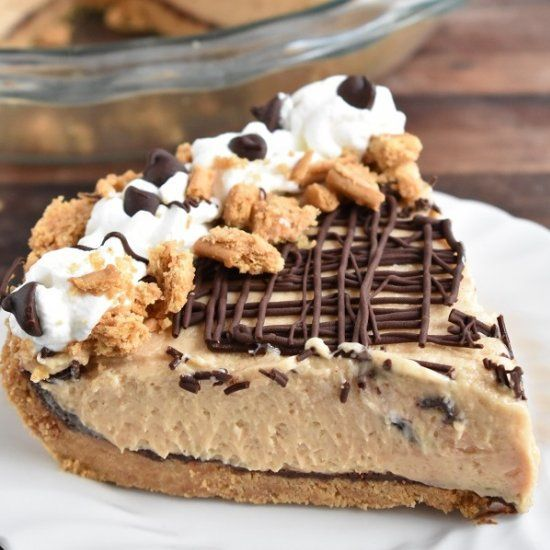 A Nutter Butter cookie crust that is slathered with chocolate ganache before adding the velvety cream cheese and peanut butter filling.