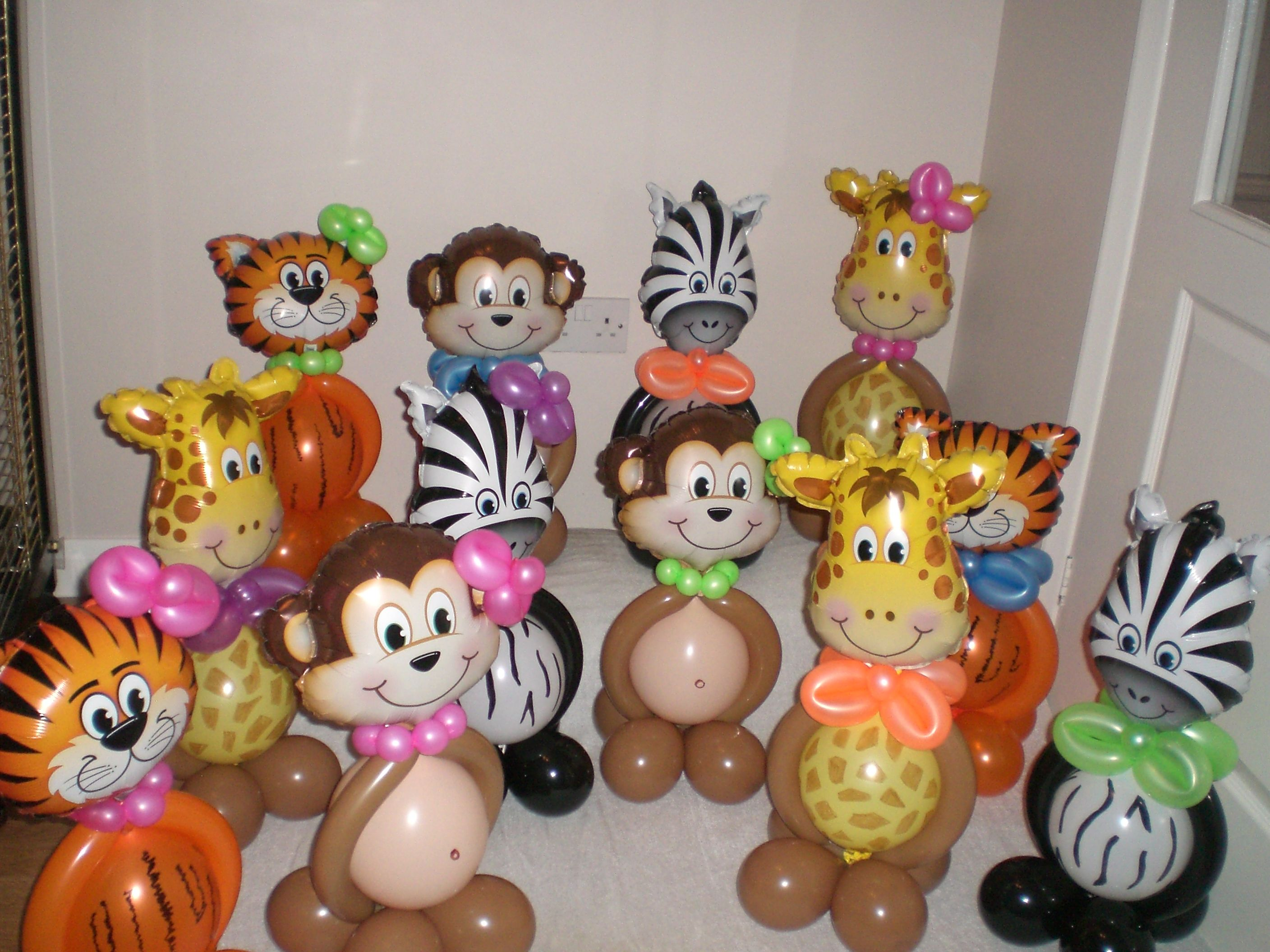 Animal centerpieces can hold helium filled balloons in