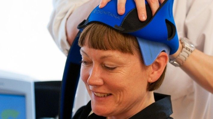 Nurse Places The Dignicap Cool Cap On Woman S Head Reduce Hair