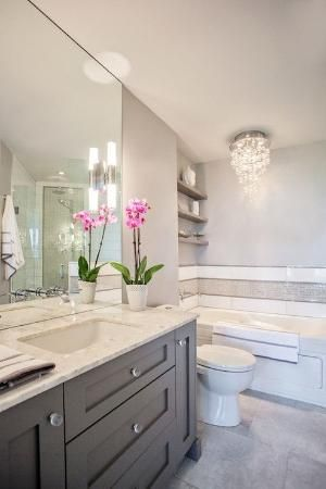 Love the cabinet colour and and massive mirror. Very elegant bathroom!