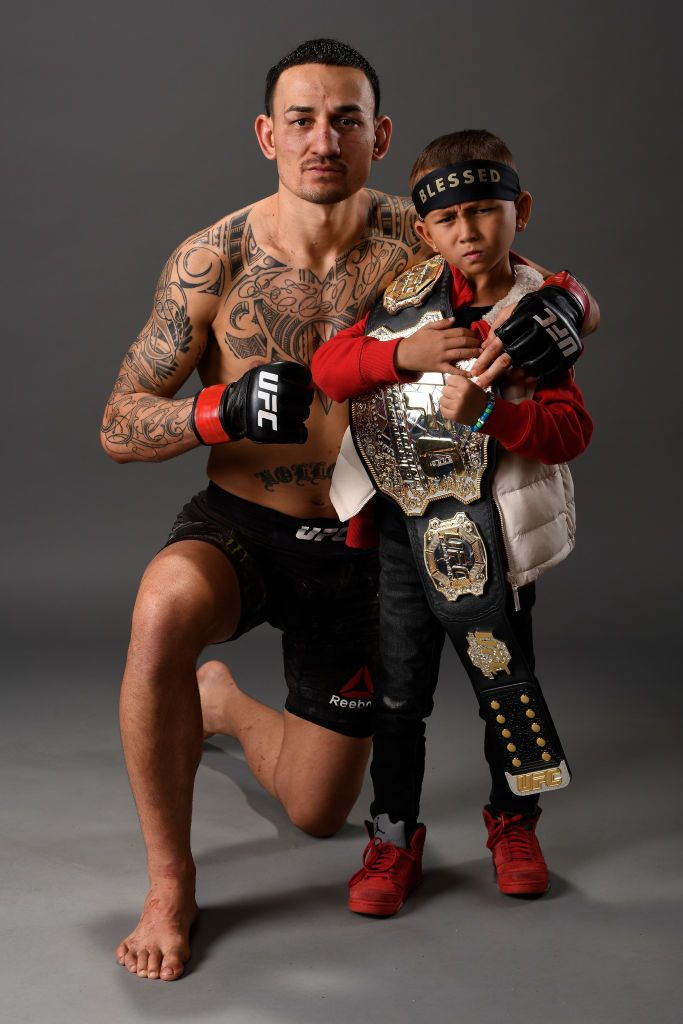 Max Holloway Poses For A Portrait Backstage With His Son During The Ufc Boxing Ufc Fighters Mma Boxing