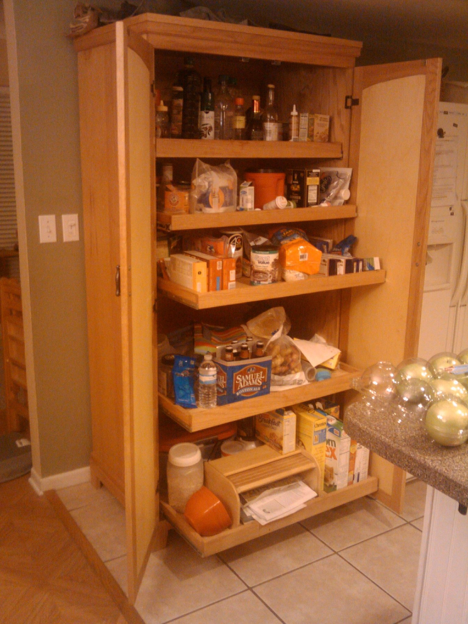Captivating Farm House Brown Varnished Wooden Food Pantry Kitchen Cabinet With Wooden  Pull Out Drawers.