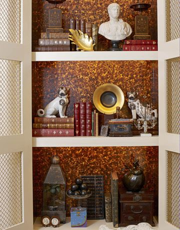 Harry Heissmann, Albert Hadley using Schumacher Tortoiseshell as a backdrop in a bookcase