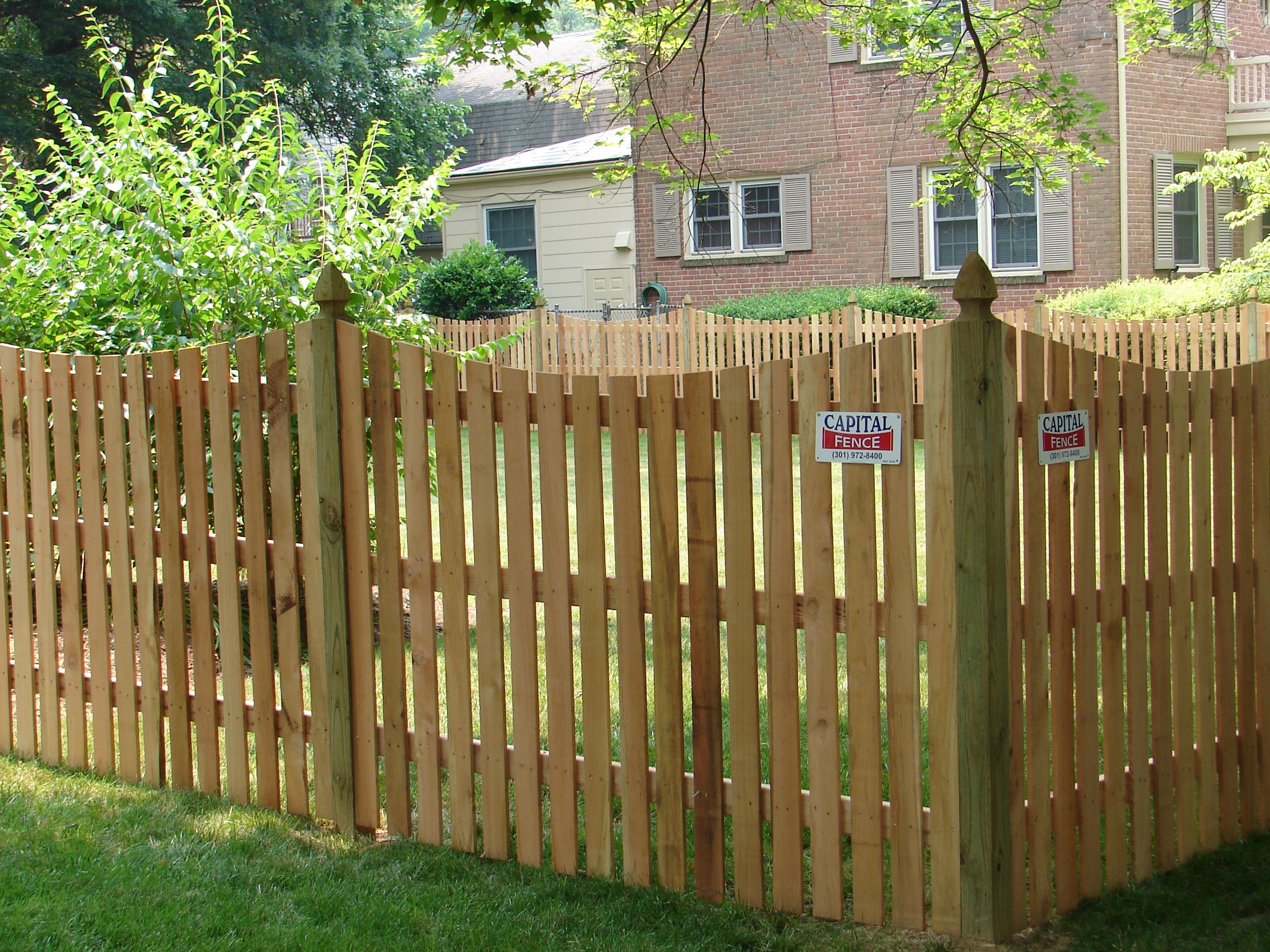 Wood Space Picket Fence With Dip And Colonial Gothic Post Caps Fence Design Fence Post Caps Fence