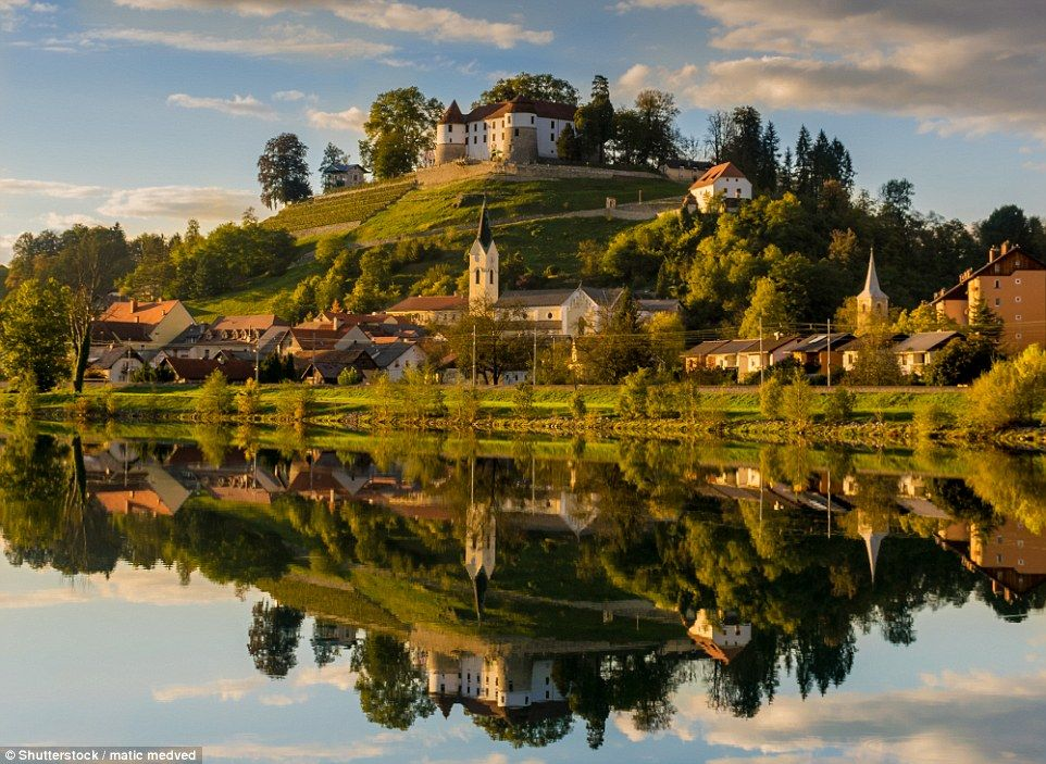 The small Slovenian town of Sevnica, pictured, is nestled in the foothills of the Alps and was once best-known for its clothing factories and 900-year-old hilltop castle