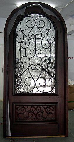 Merveilleux Wood Arch Top Front Door With Wrought Iron Details. Like This As Long As You