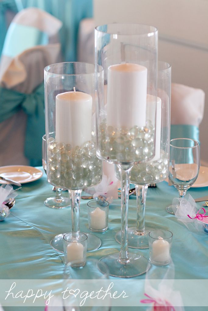 Wedding centerpiece candles in glasses with flat glass for Wine glass decorations for weddings