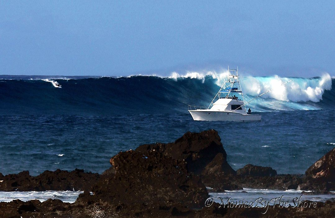 Exceptional Hatteras And A Surer Twiggy Baker Taking Off On A Bomb At Log Cabins, North  Shore Oahu, Hawaii.