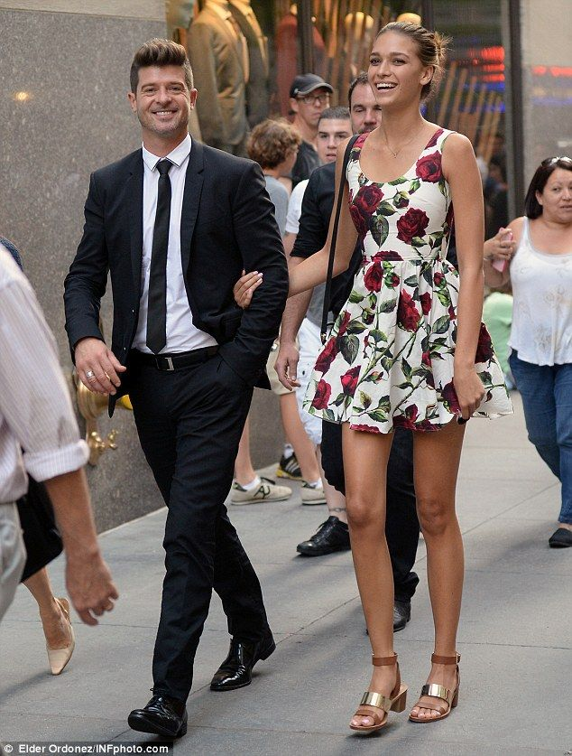 April Love Geary parades legs on day date with boyfriend Robin Thicke