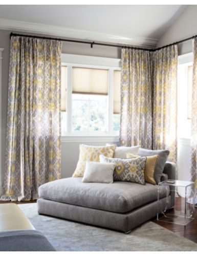 Curtain Rods Are Placed High Above The Window To Create Height Notice That Ceiling Is Straight Along One Wall And Vaulted On Other
