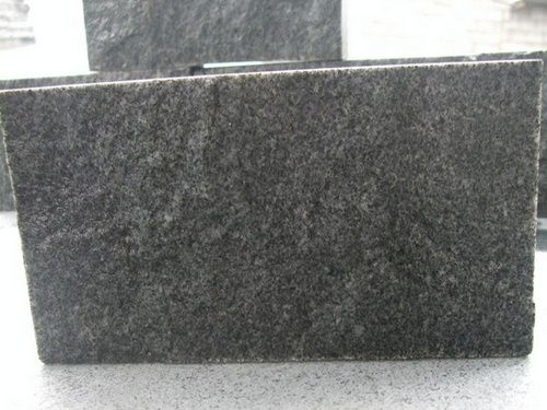 Split Padang Dark Granite Tiles Supplier And Exporter