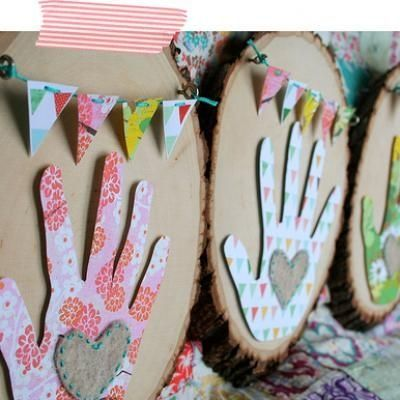 paper cut out hand print glued to wood for v-day, mommy day or just as a cute craft for the wall