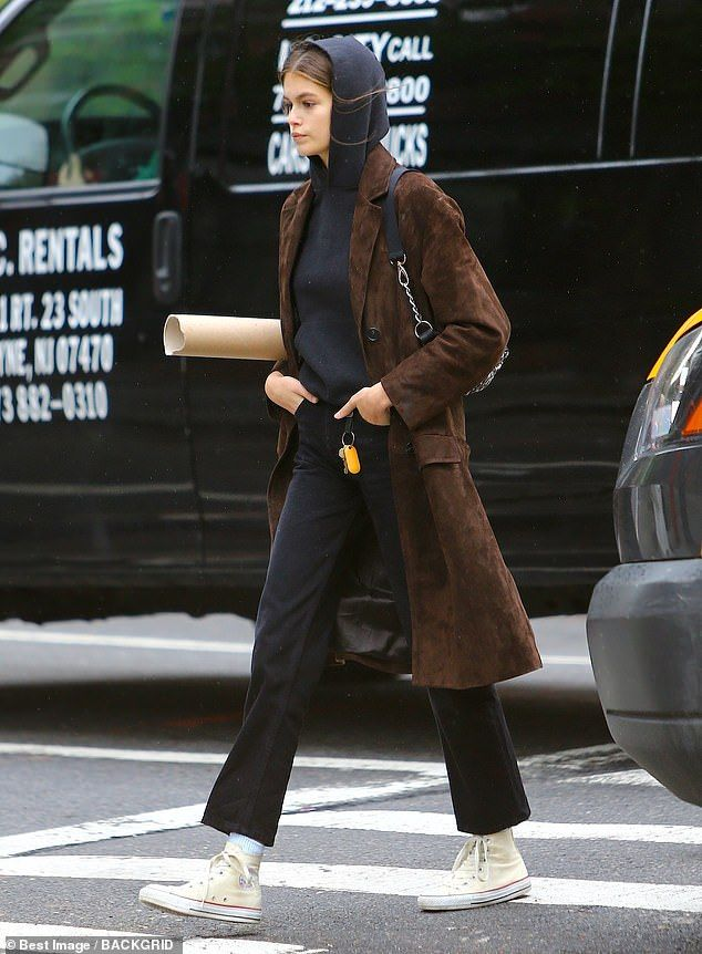 Kaia Gerber sports a casual brown jacket while out for a walk in NYC