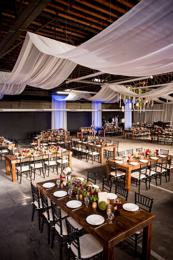 Long rectangular tables in a warehouse wedding