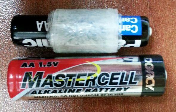 Emergency Battery Hack Make An Aaa Battery Work As An Aa Battery Battery Hacks Aaa Batteries Battery