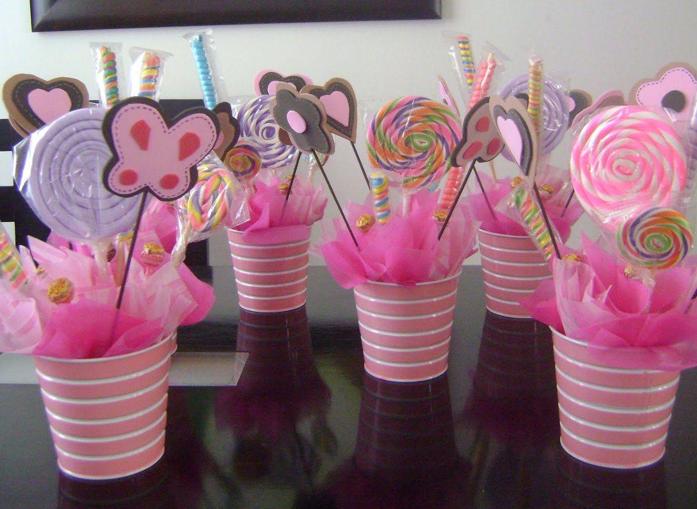 centros de mesa rosa con paletas on consejos