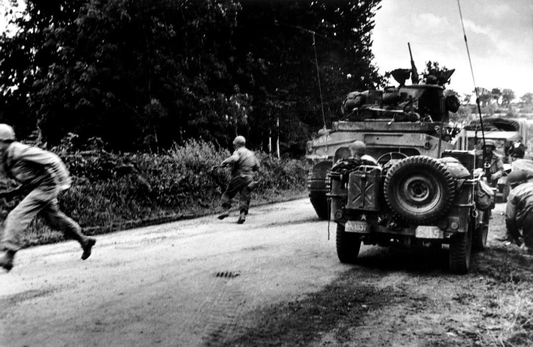 South-west of St. Lô. July 26th-30th, 1944. American troops under fire.