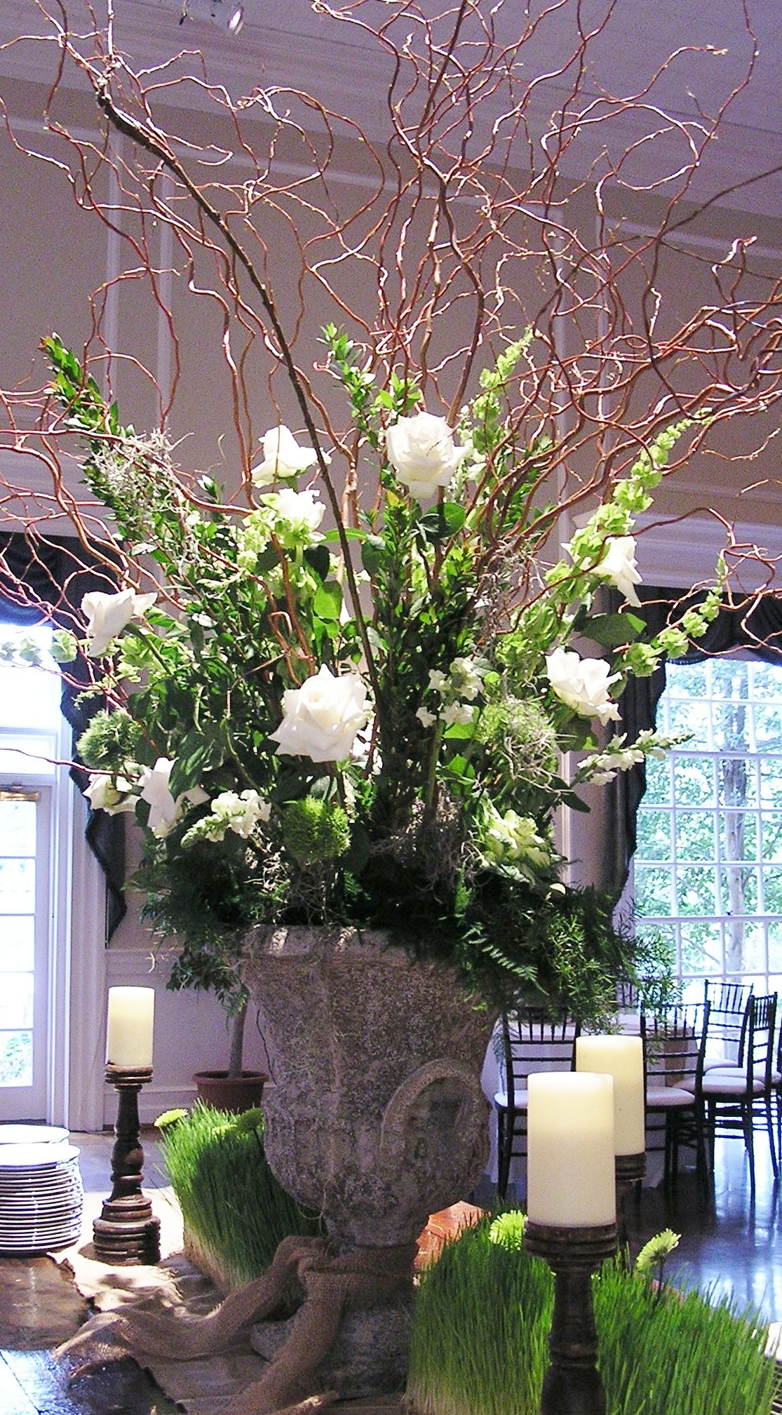A green and white wedding Large arrangement with curly