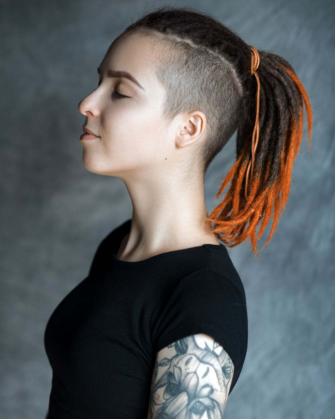 dreadlock girl with shaved sides and ponytail in 2019