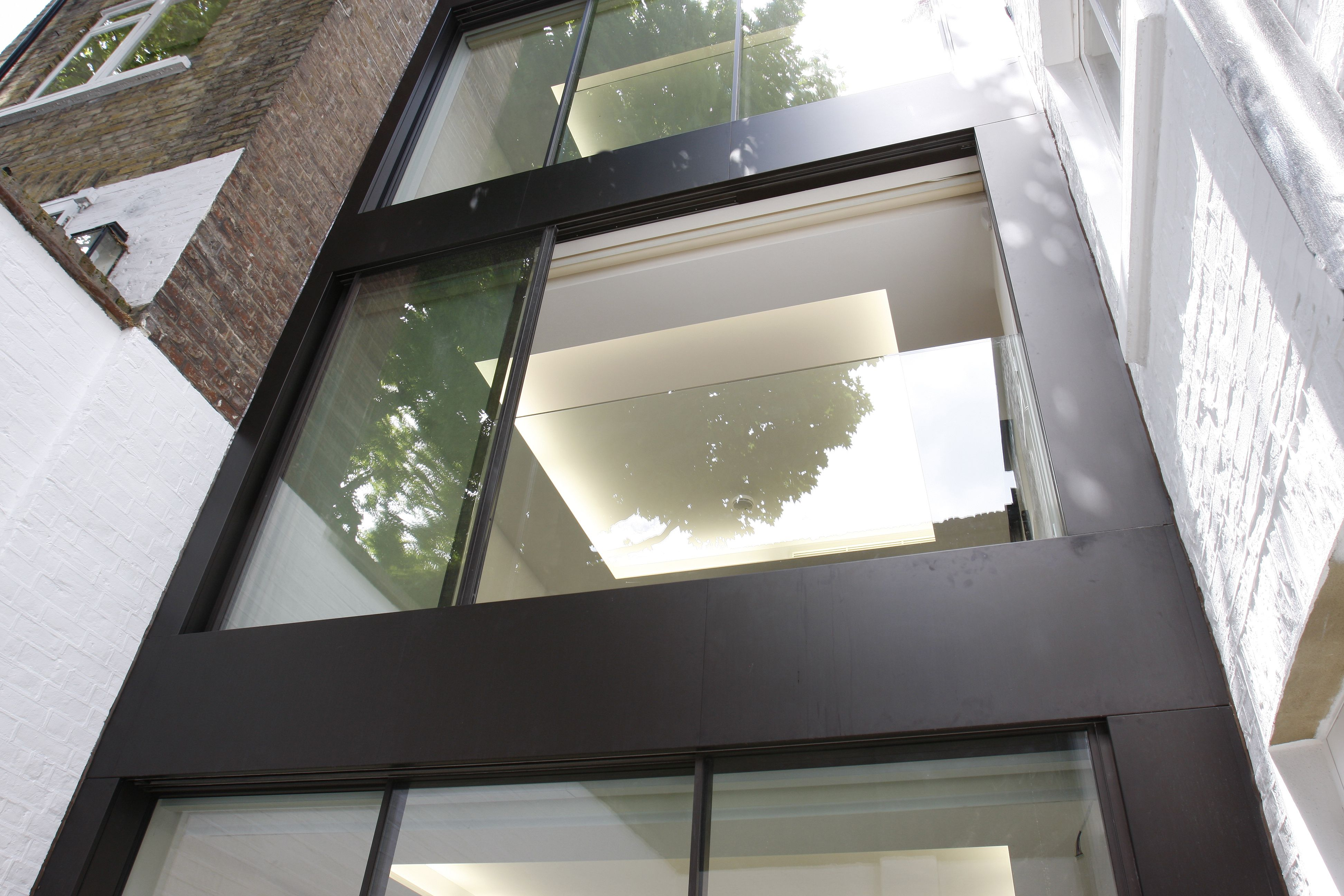 For minimal windows on the upper floors we fixed a for Large opening sliding glass doors