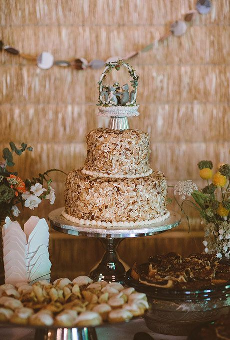 A rustic, whimsical wedding cake topper with squirrels | Brides.com