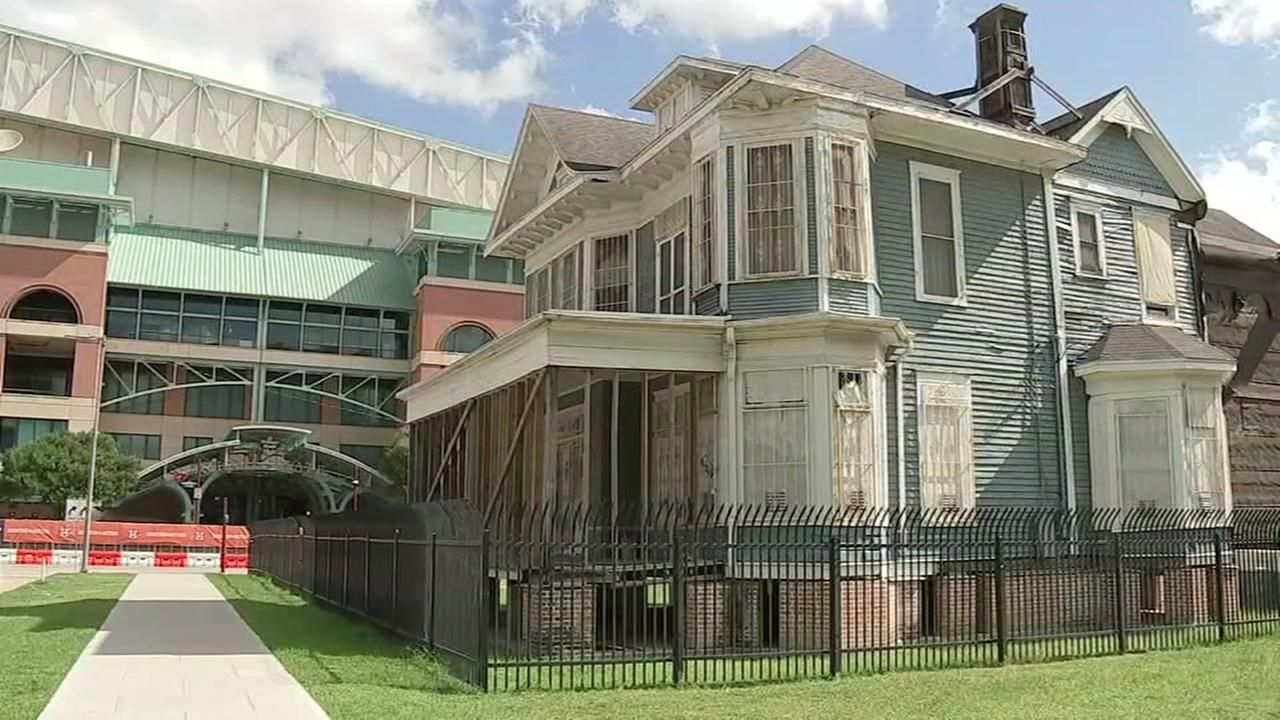 A Little Blue House Sits In The Shadow Of Minute Maid Park In Downtown Houston Astros Fans Often Walk By The Two Story Struc Blue House Minute Maid Park House