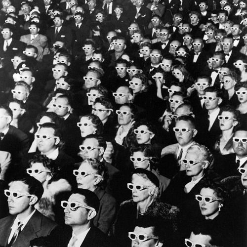 Movie goers watching Bwana Devil in 3-D at the Paramount Theater in Hollywood, California - 1952. (J.R. Eyerman—The LIFE Picture Collection/Getty Images)