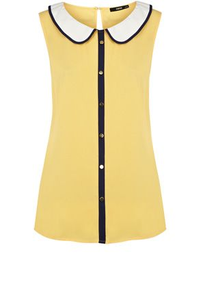 This sleeveless blouse has a piped peter pan collar and faux buttons down the front.