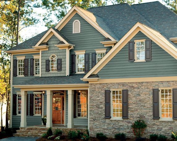 Craftsman Style Home With Beautiful Wood Garage Doors